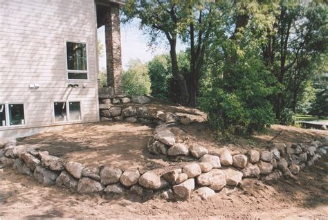 boulder wall contractor mn rock wall installation st