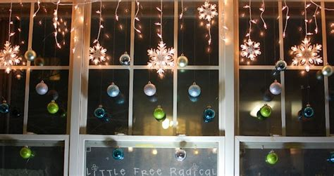 hanging christmas lights in windows easy hang ornaments in the window a strand of lights blue green decor