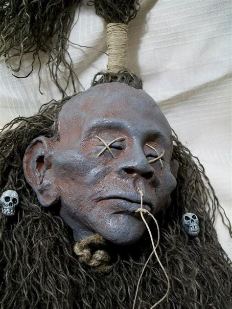 shrunken head creepy shrunken head with skull beads