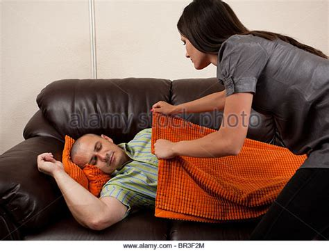 my husband sleeps on the couch good night kiss stock photos good night kiss stock