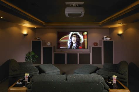 castle pines basement with home theater exercise room