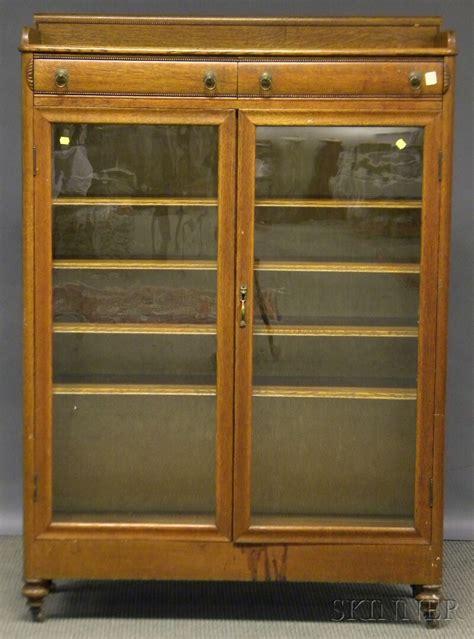 Book Cabinet With Doors Early 20th Century Carved Oak Two Door Book Cabinet Sale Number 2597m Lot Number 736