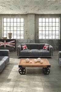 These denim sofas work well with the industrial warehouse floor and