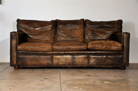 distressed brown leather couch need a couch like this in my life sitting on thick wood