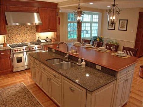 tiered island kitchen   kitchen island  stove traditional kitchen kitchen