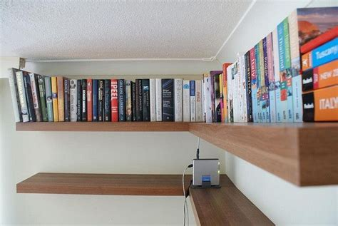 floating bookshelves at ceiling level floating corner