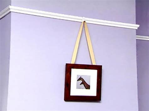hang pictures weekend project how to hang picture railing hgtv