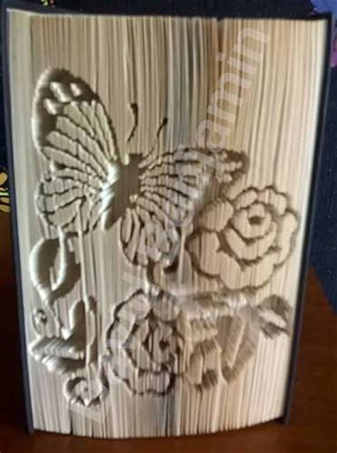Book Origami Patterns - butterfly with flowers cut fold book folding pattern