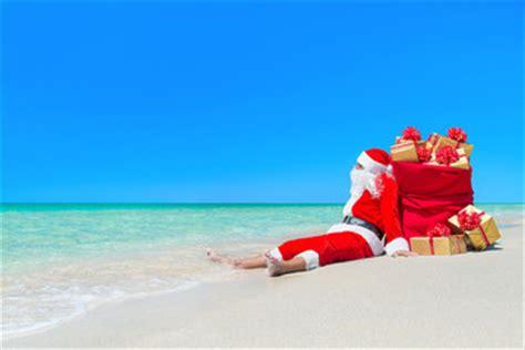imagenes de santa claus en la playa emrpize photos images assets adobe stock