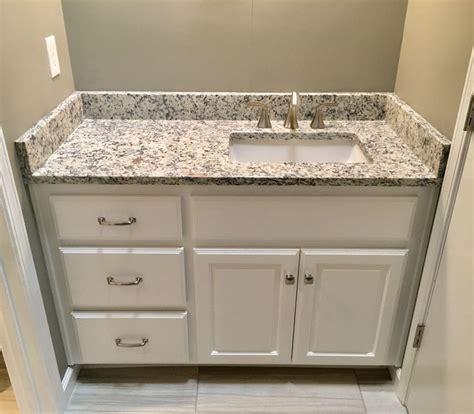 "Ashen white granite countertops, Moen 8"" widespread faucet"