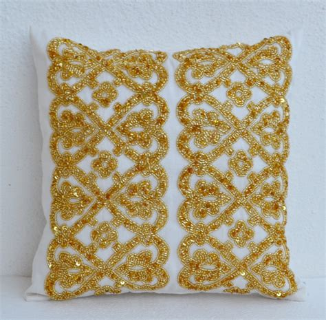 gold beaded pillow white geometric throw pillows beaded detail gold bead