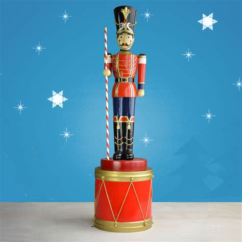 life sized toy soldier with baton on drum 107in