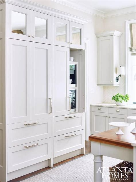 built cabinets: square mirrored cabinets stacked atop pantry cabinets hiding a built