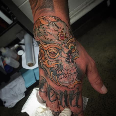tattoo in hand for men skull tattoos designs ideas and meaning tattoos