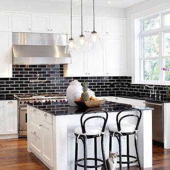 black subway tile backsplash white kitchen cabinets with black brick tile backsplash