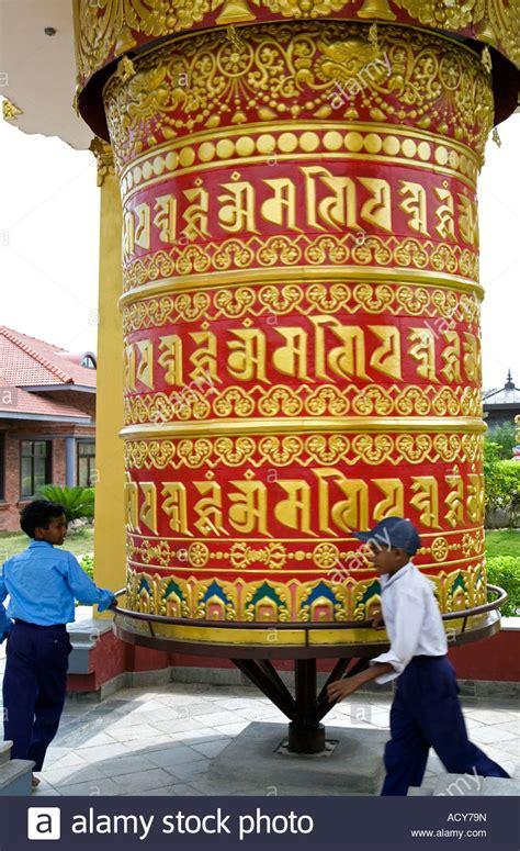 large buddhist prayer children spinning a big prayer wheel german buddhist