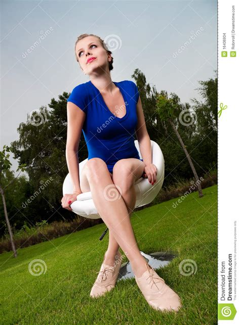 outdoor sitting girl sitting outdoor on a swivel chair stock images