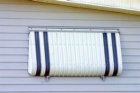 hurricane awnings the dangers of leaving your hurricane shutters up all year