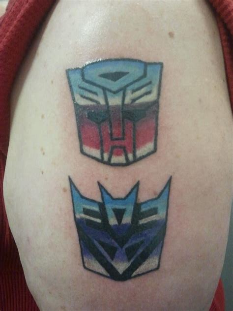 transformers autobot and decepticon tattoos by hakushaku
