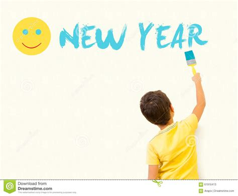 new year boy boy painting happy new year with brush on the
