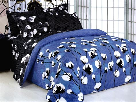 dark blue coverlet dark blue and cream stripped on the white base bedding