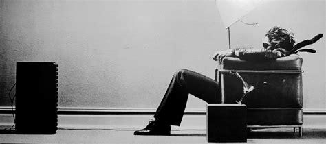 Sitting In Chair In Front Of Speaker by Andy Zeo Steve Steigman