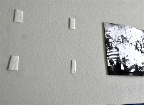 how to put photos on wall without tape 5 rent friendly ways to display art without damaging your