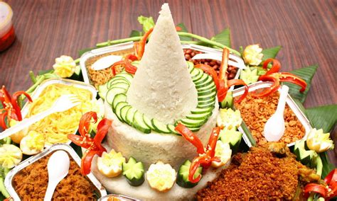traditional cuisine tumpeng is how the presentation of rice and side dishes in
