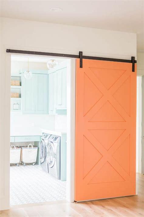 barn door laundry room laundry room with orange barn door transitional laundry room