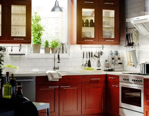 white tile backsplash with cherry cabinets kitchen