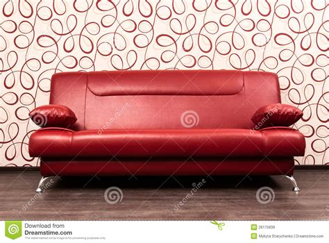rotes sofa modern sofa in front of the wall stock image image