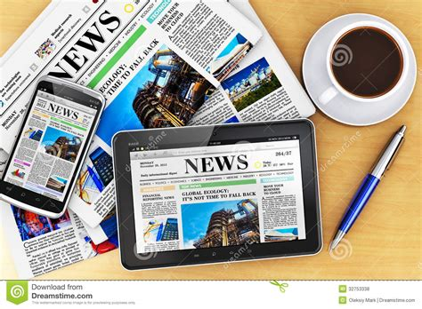 mobile and news tablet computer smartphone and newspapers royalty free