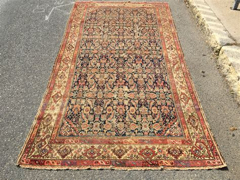 large thin rug what remains of a genuine antique ferrahan rug thin with overall low pile tears