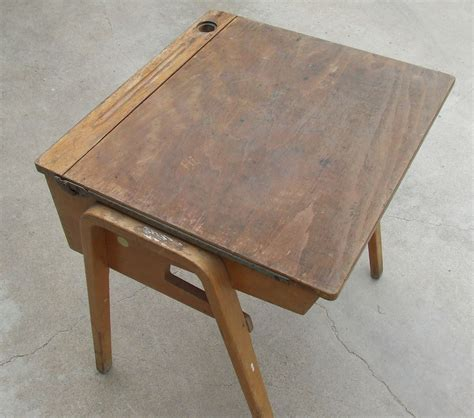great wooden school desk complete with graffiti