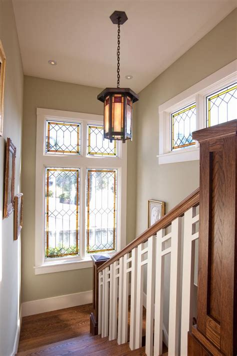 craftsman staircase  light green walls stained glass