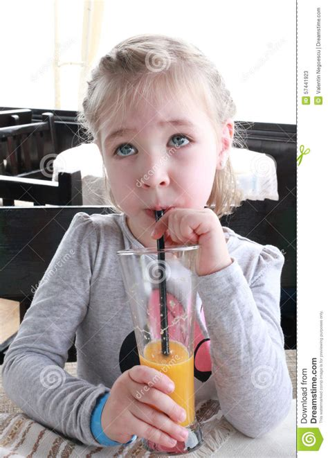 desk for 6 year old sweet little is drinking orange juice through a straw