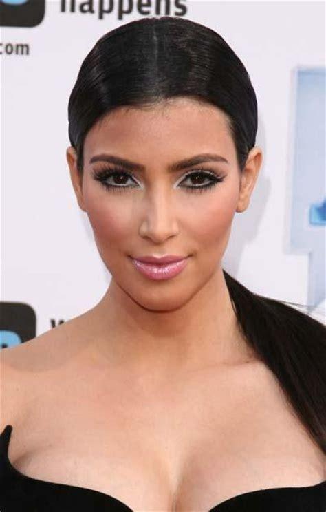 Kim Kardashians Low Sleek Ponytail With Center Part Celebrity   celebrity hairstyles kim kardashian s low sleek ponytail
