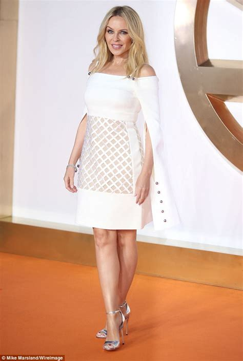 Minogues White by Minogue Wows In White Dress At Kingsman Premiere