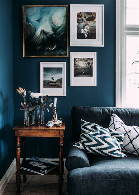 living room with blue walls 6 best paint colors to get you those moody vibes