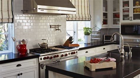 White Cabinets Black Counter by Striped Shades Transitional Kitchen Vallone Design