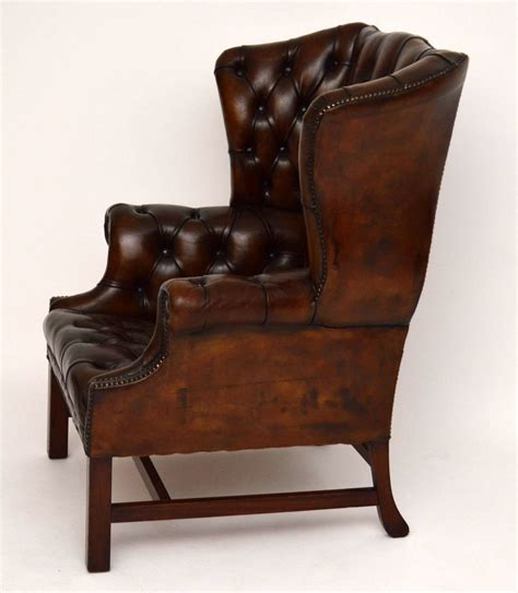 reclaimed armchair antique wide deep buttoned leather wing back armchair