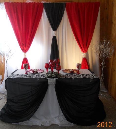wedding backdrop design red a black and red backdrop and head table design by