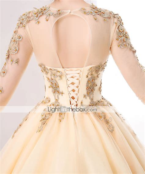 beading on the wedding dress to the right reminds me of indian ball gown wedding dress cathedral train scoop tulle with