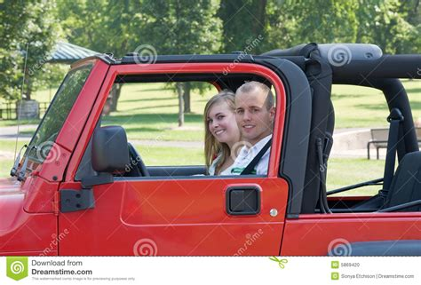 jeep couple couple in red jeep stock photo image 5869420