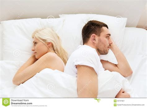 lie in bed unhappy couple lying in bed at home stock image image