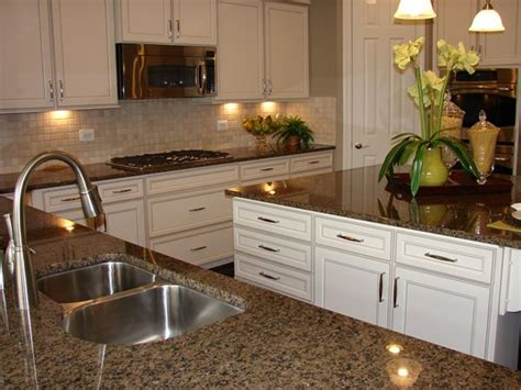 Brown Countertops White Cabinets by 25 Great Ideas About Brown Granite On