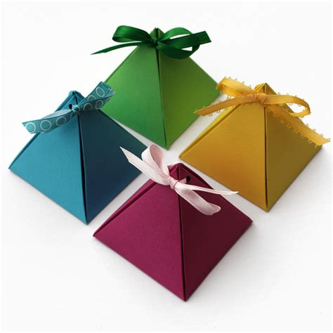 How To Make Gift Boxes From Paper - paper pyramid gift boxes lines across