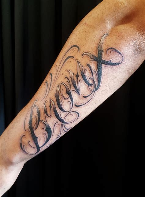 outer arm tattoo custom lettering bronx on outer forearm chronic