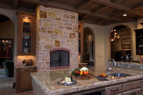 kitchen with fireplace designs tuscan inspired kitchen view of fireplace