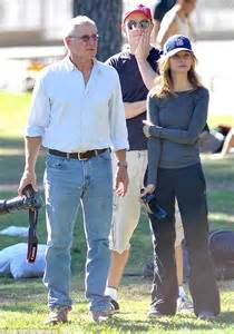 harrison ford and calista flockhart take photos for the